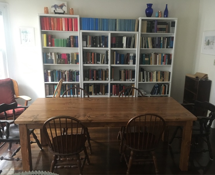 Dining Table in front of a bookcase