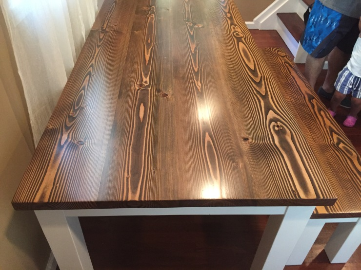 dark walnut farmhouse table and accent bench