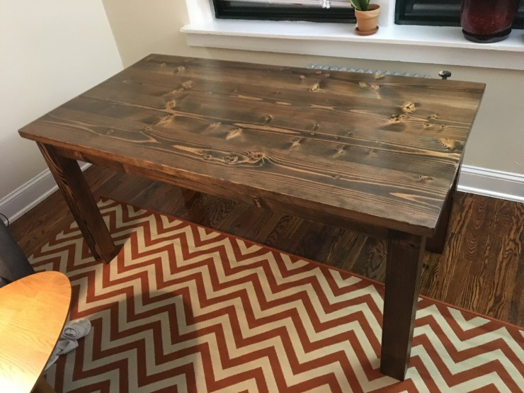 A dark walnut Table in an apartment in Queens NYC