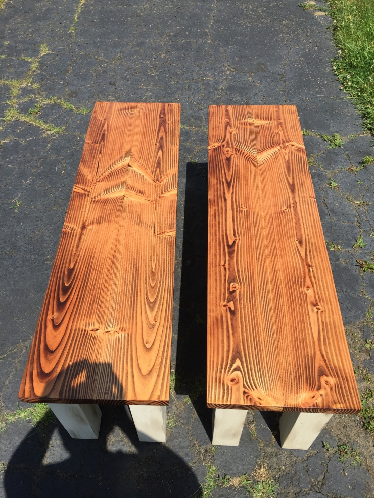a pair of bookmatched dining benches
