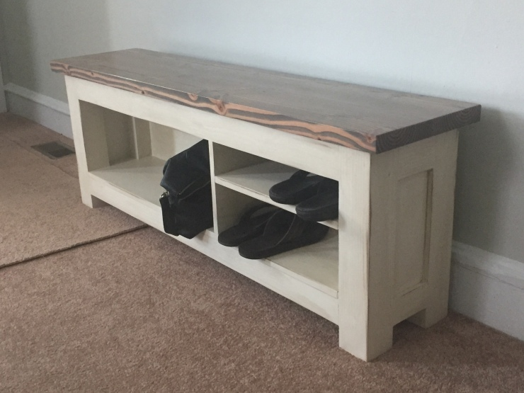 Distressed grey and white storage bench in Philadelphia home