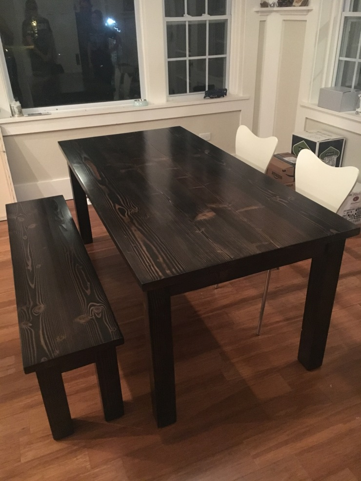 All black farmhouse kitchen table and bench