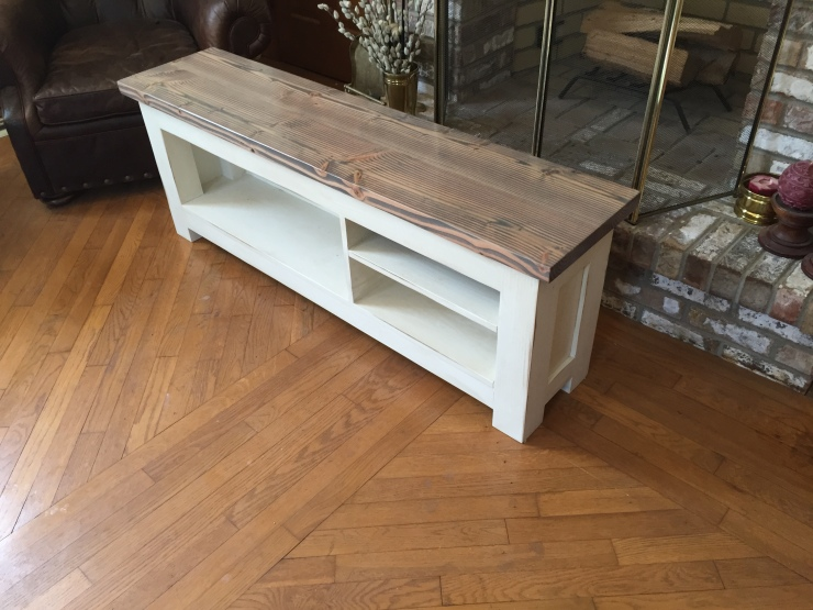 grey and white farmhouse bench for storing shoes and clothes
