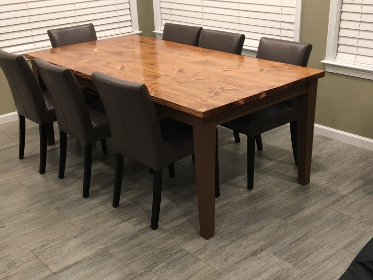 farmhouse table with tapered brown legs