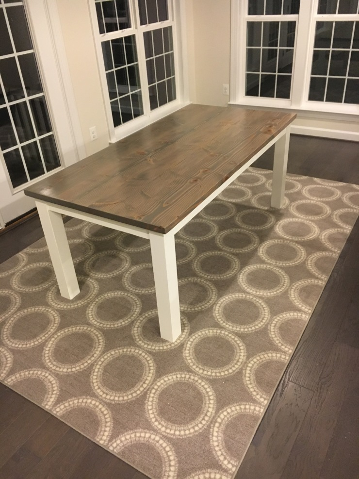 Grey and White Farmhouse Table on a rug