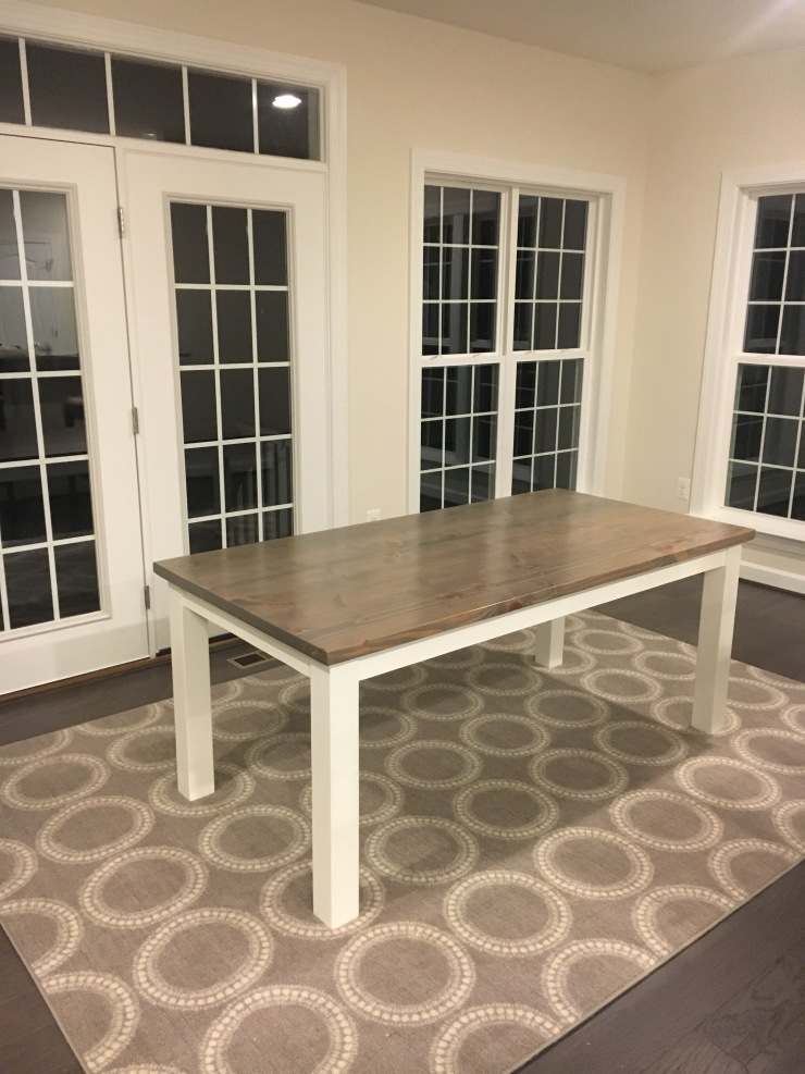 Grey and White Farmhouse Table on a grey rug