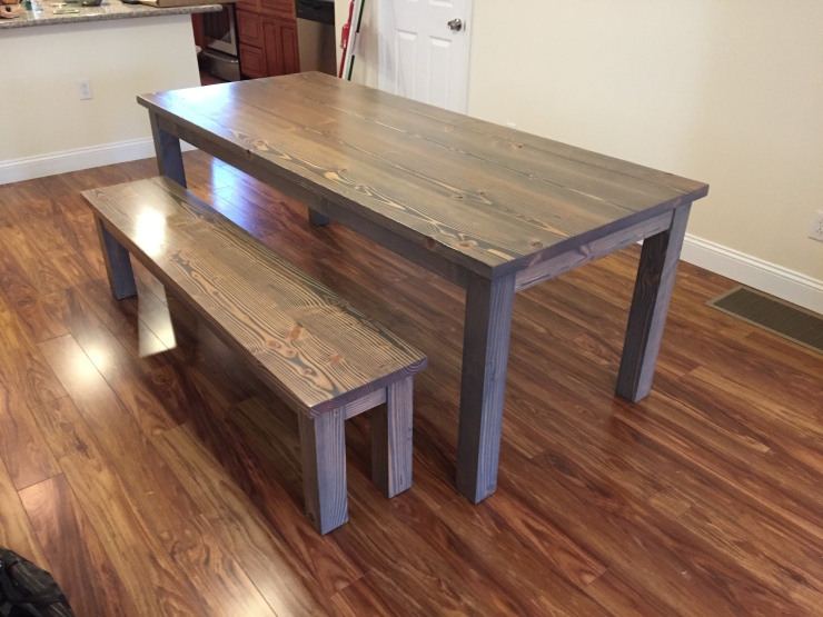 gray wood farmhouse table and bench