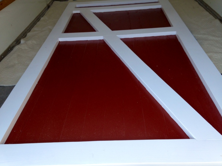 Red and White Barn Door with diagonal braces